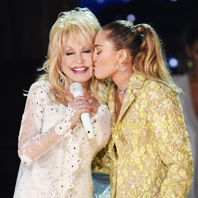 Miley Cyrus on stage with Dolly Parton