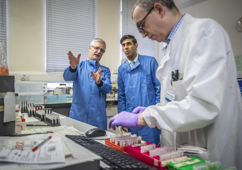 Chancellor Rishi Sunak is shown the testing of samples for respiratory viruses by Dr Antony Hale (L) during a visit to the pathology labs at Leeds General Infirmary on March 12, 2020 in Leeds, England. This is the same procedure that will be used by the lab when it begins to receive coronavirus samples for testing. Photo: by Danny Lawson - WPA Pool/Getty Images