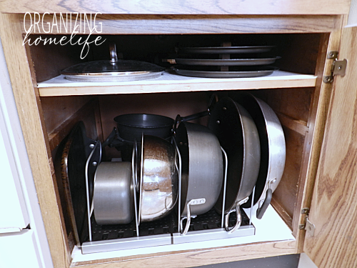 """<p>To keep you little piggies safe, use organizers that let you stack items on their sides. Then, all you have to do when you need a pan is pull it out without having to worry about causing a kitchen disaster.</p><p><em><a href=""""http://www.organizinghomelife.com/diy-knock-off-organization-for-pots-pans-how-to-organize-your-kitchen-frugally-day-26/"""" rel=""""nofollow noopener"""" target=""""_blank"""" data-ylk=""""slk:See more at Organizing Home Life »"""" class=""""link rapid-noclick-resp"""">See more at Organizing Home Life »</a></em></p><p><strong>What you'll need: </strong><span class=""""redactor-invisible-space"""">cabinet organizers, $18, <a href=""""https://www.amazon.com/Organized-Living-Sort-Divider-White/dp/B00525W1BY/?tag=syn-yahoo-20&ascsubtag=%5Bartid%7C10072.g.36006557%5Bsrc%7Cyahoo-us"""" rel=""""nofollow noopener"""" target=""""_blank"""" data-ylk=""""slk:amazon.com"""" class=""""link rapid-noclick-resp"""">amazon.com</a></span><br></p>"""
