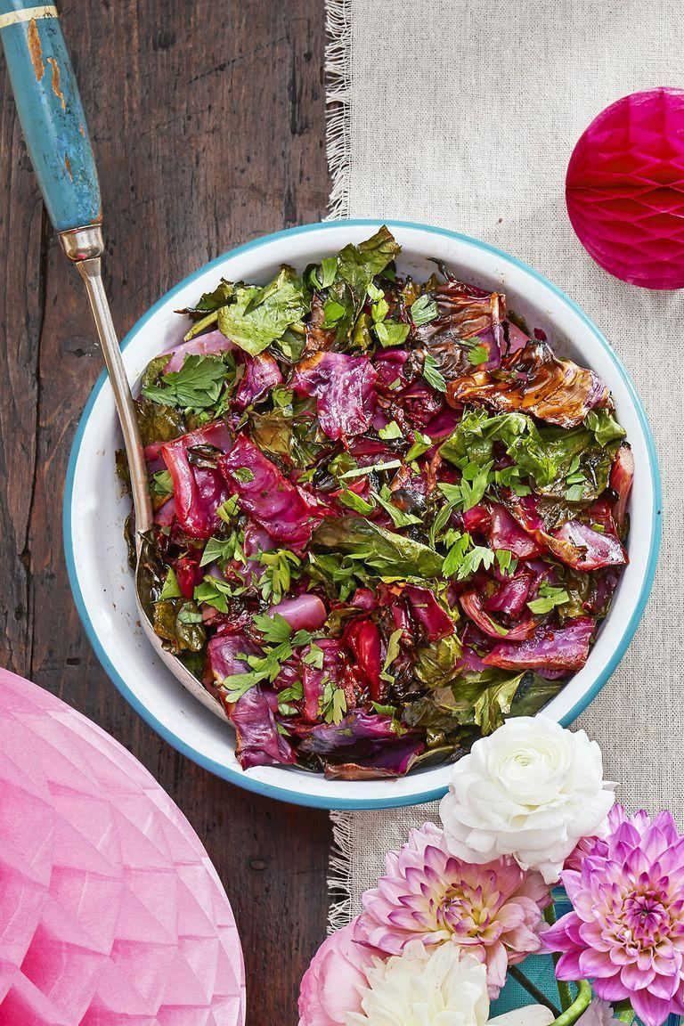 "<p>A sweet-and-spicy sauce packs adds tons of unexpected flavor to this slaw. It features <a href=""https://www.countryliving.com/food-drinks/g1028/cider-recipes/"" rel=""nofollow noopener"" target=""_blank"" data-ylk=""slk:apple cider"" class=""link rapid-noclick-resp"">apple cider</a> and red pepper flakes.</p><p><strong><a href=""https://www.countryliving.com/food-drinks/a22667199/roasted-red-cabbage-and-collard-green-slaw-recipe/"" rel=""nofollow noopener"" target=""_blank"" data-ylk=""slk:Get the recipe"" class=""link rapid-noclick-resp"">Get the recipe</a>.</strong></p><p><strong><strong><a class=""link rapid-noclick-resp"" href=""https://go.redirectingat.com?id=74968X1596630&url=https%3A%2F%2Fwww.walmart.com%2Fip%2FWilton-Bake-It-Better-Non-Stick-Baking-Pan-Set-3-Piece%2F44432741&sref=https%3A%2F%2Fwww.countryliving.com%2Ffood-drinks%2Fg34470406%2Fvegetarian-christmas-dinner%2F"" rel=""nofollow noopener"" target=""_blank"" data-ylk=""slk:SHOP BAKING SHEETS"">SHOP BAKING SHEETS</a></strong><br></strong></p>"