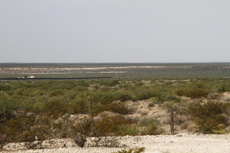 A crane can be seen at the beginning of new border wall construction about 20 miles west of Santa Teresa, New Mexico, Aug. 23, 2019. The wall visible on the left was built in 2018 with money allocated by Congress, while the new construction is funded by money reallocated from Department of Defense funding. (AP Photo/Cedar Attanasio)