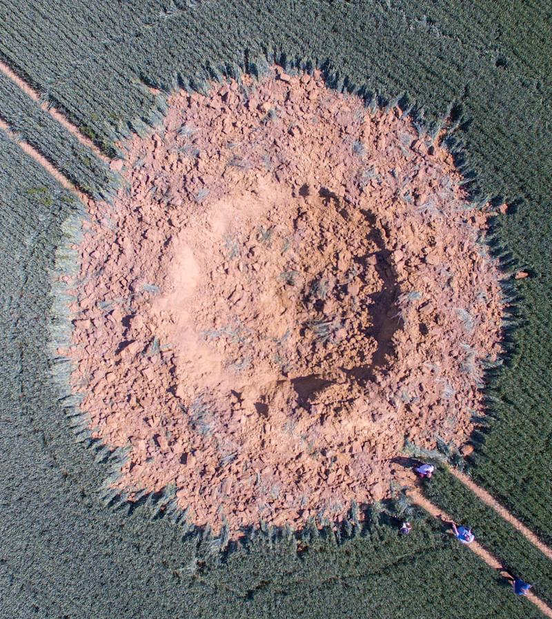 A crater is pictured in a corn field after a bomb from World War II exploded in Halbach, Germany. (Photo: ASSOCIATED PRESS)