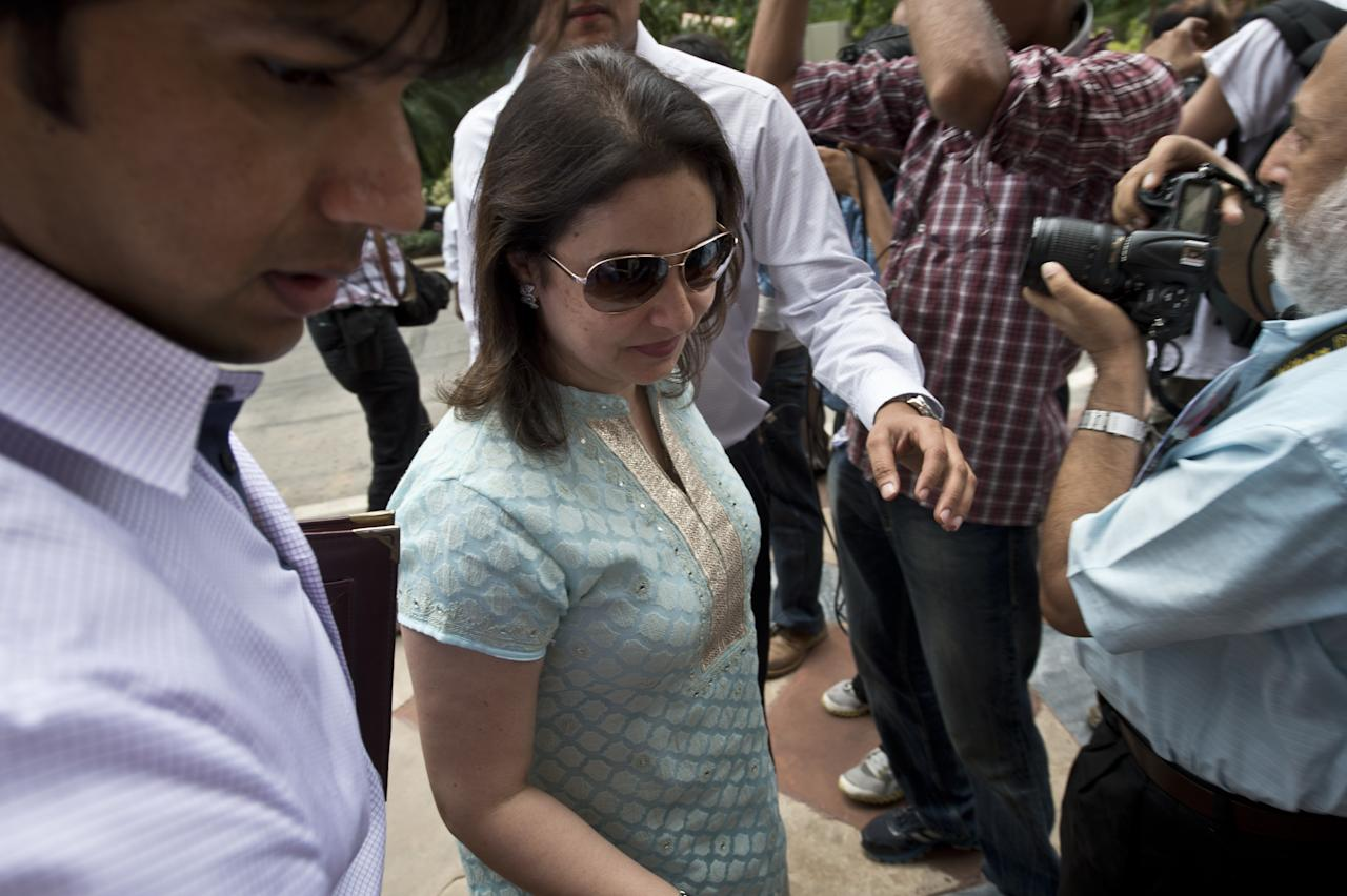 Indian cricketer and Member of Parliament Sachin Tendulkar's wife Anjali Tendulakar arrives at Parliament in New Delhi on August 5, 2013. India's parliament is due to start the monsoon session with the government under intense pressure to pass key bills ahead of upcoming elections due by next year. AFP PHOTO/ Prakash SINGH        (Photo credit should read PRAKASH SINGH/AFP/Getty Images)