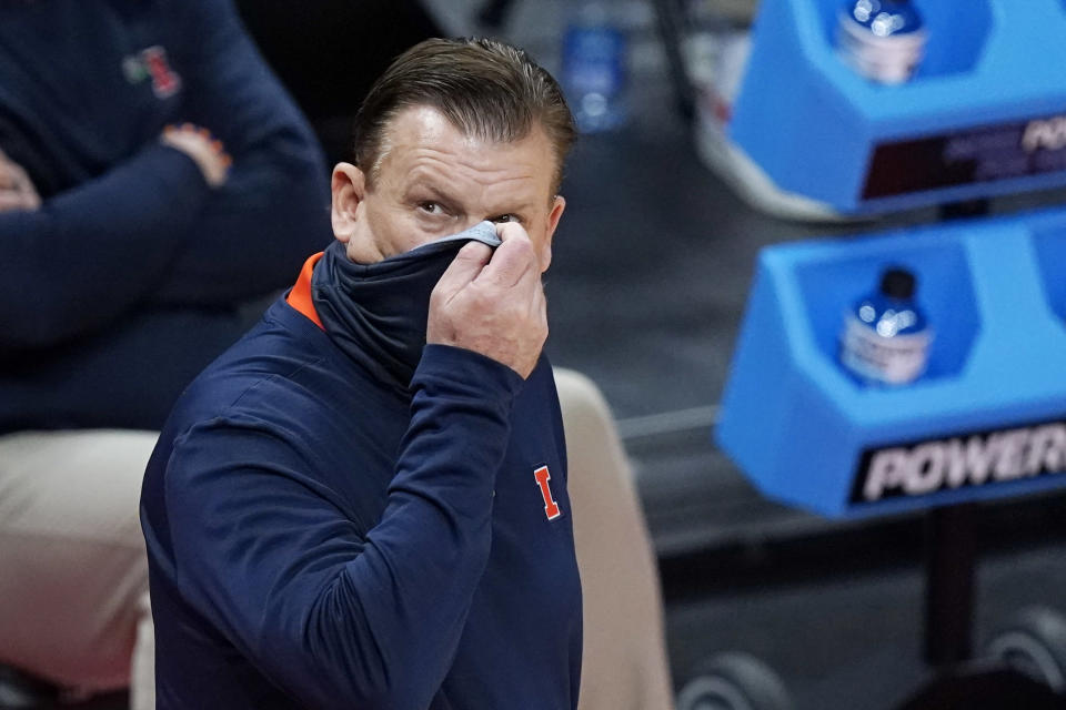 Illinois head coach Brad Underwood looks up at the scoreboard during the second half of a college basketball game against Loyola of Chicago in the second round of the NCAA tournament at Bankers Life Fieldhouse in Indianapolis Sunday, March 21, 2021. Loyola upset Illinois 71-58. (AP Photo/Mark Humphrey)