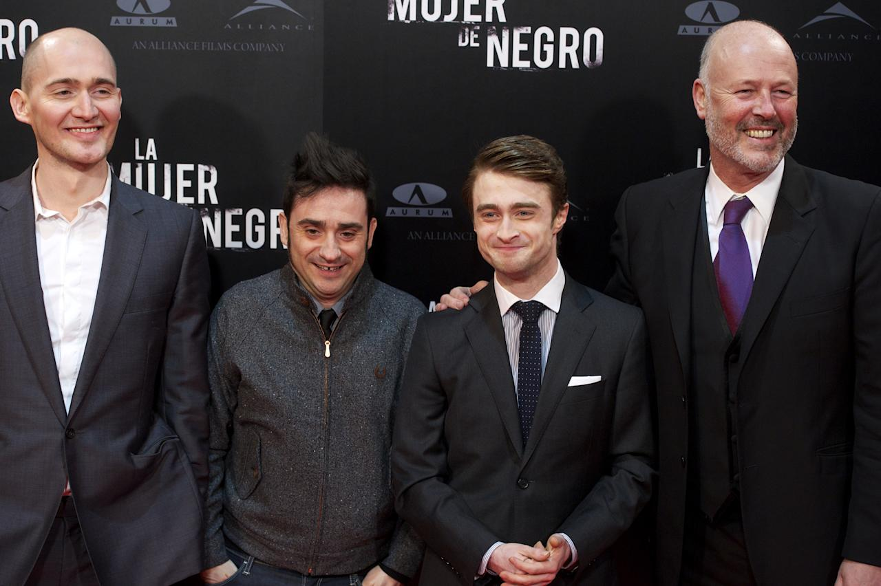 "MADRID, SPAIN - FEBRUARY 14:  (L to R) Director James Watkins, Spanish director Juan Antonio Bayona, actor Daniel Radcliffe and producer Simon Oakes attend ""The Woman in Black"" (La Mujer de Negro) premiere at Callao cinema on February 14, 2012 in Madrid, Spain.  (Photo by Carlos Alvarez/Getty Images)"
