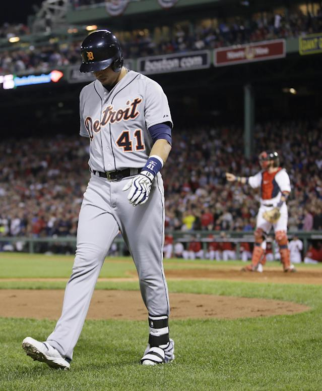 Detroit Tigers' Victor Martinez walks to the dugout after striking out in the eighth inning during Game 6 of the American League baseball championship series against the Boston Red Sox on Saturday, Oct. 19, 2013, in Boston. The Red Sox won 5-2 to advance to the World Series. (AP Photo/Matt Slocum)