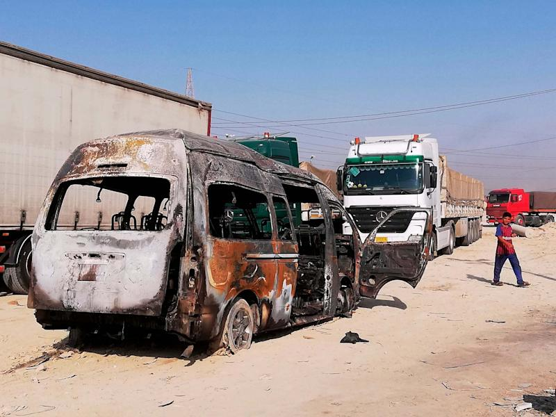 A destroyed minibus sits near an Iraqi army checkpoint outside of Karbala, Iraq: AP