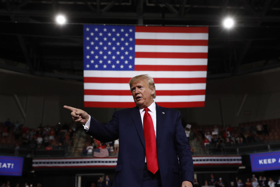 FILE - In this Aug. 15, 2019 file photo, President Donald Trump reacts at the end of his speech at a campaign rally in Manchester, N.H. The Trump administration is aggressively pursuing economic sanctions as a primary foreign policy tool to an extent unseen in decades, or perhaps ever. Many are questioning the results even as officials insist the penalties are achieving their aims. (AP Photo/Patrick Semansky, File)