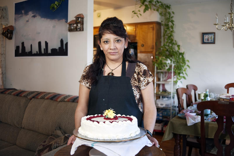 Ana Soria with a cake she made in March 2011. | Luis Eduardo Chimbo.