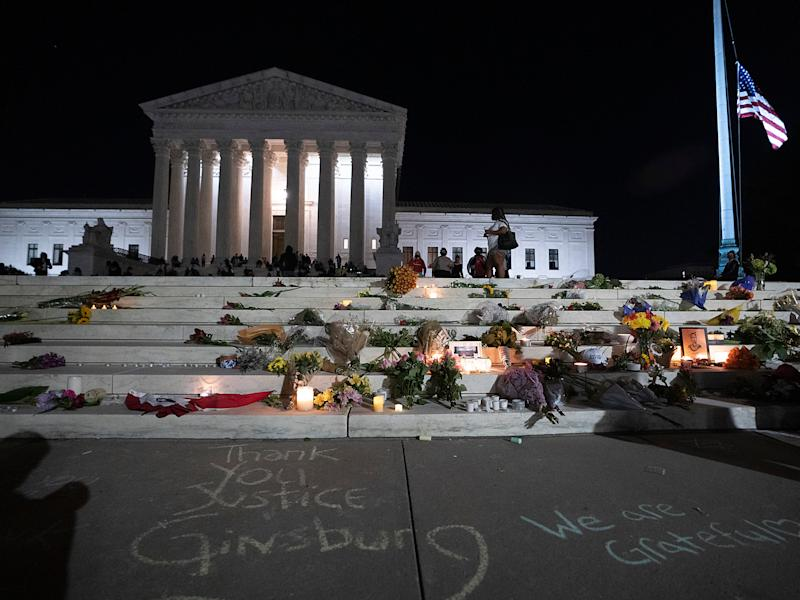 People gather to mourn the passing of Ruth Bader Ginsburg in front of the Supreme CourtGetty Images