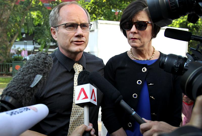 Parents of the late American Shane Todd, Mary, right, and Rick Todd, left, arrive to waiting press at the Subordinate Courts on Monday, May 13, 2013, in Singapore. Todd was found hanged in his apartment last June in an apparent suicide. However, his family believe that the 31-year-old was murdered over research he did, possibly involving technology transfers with China, while working for the Institute of Microelectronics (IME) in Singapore.  (AP Photo/Wong Maye-E)
