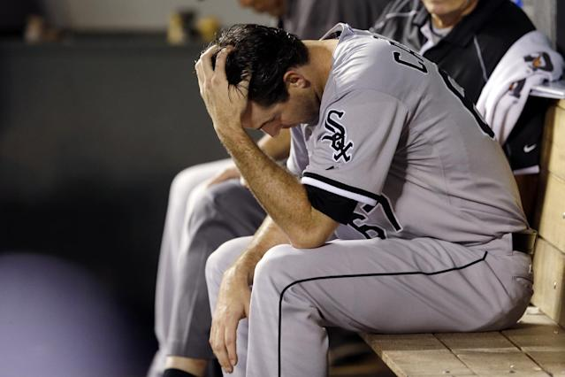 Chicago White Sox starting pitcher Scott Carroll sits in the dugout after he was pulled in the sixth inning of a baseball game against the Seattle Mariners, Thursday, Aug. 7, 2014, in Seattle. (AP Photo/Ted S. Warren)