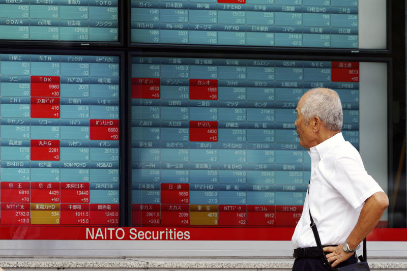 A man looks at an electronic stock board showing Japan's Nikkei 225 index at a securities firm in Tokyo Wednesday, Oct. 2, 2019. Asian shares are lower after U.S. stocks posted their worst loss in five weeks on Wednesday after a surprisingly limp report on the nation's manufacturing that stirred worries about the economic outlook. (AP Photo/Eugene Hoshiko)