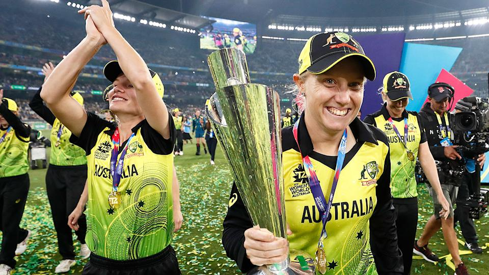 Seen here, Alyssa Healy holds the Women's T20 World Cup trophy in celebration.