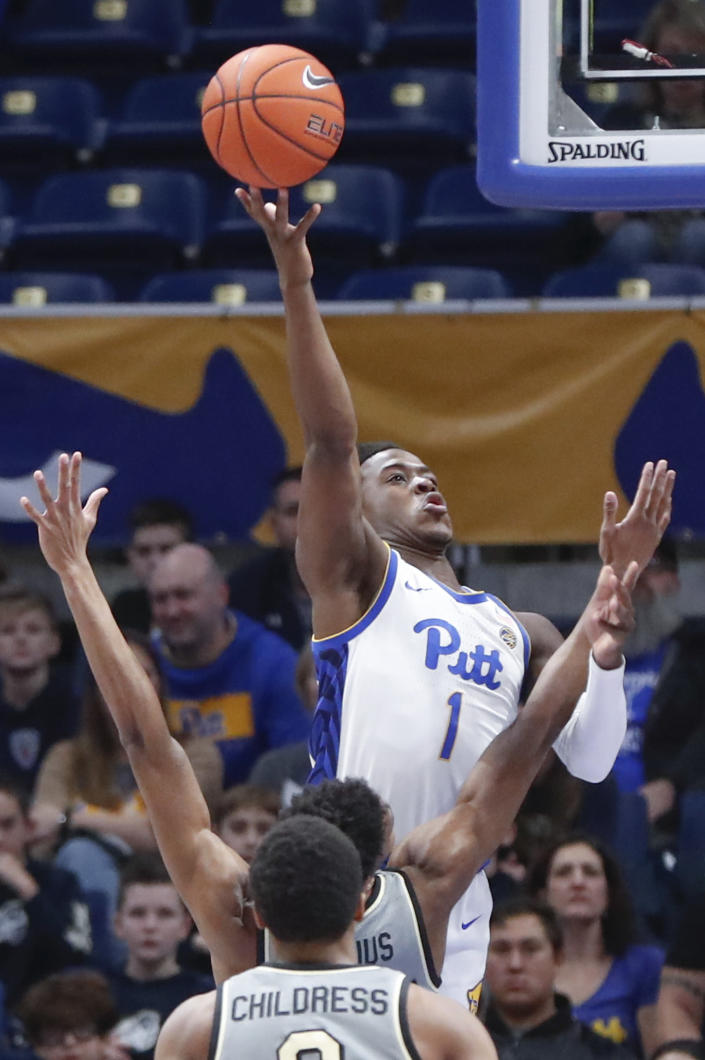 Pittsburgh's Xavier Johnson (1) shoots over Wake Forest's Isaiah Mucius during the first half of an NCAA college basketball game, Saturday, Jan. 4, 2020, in Pittsburgh. (AP Photo/Keith Srakocic)