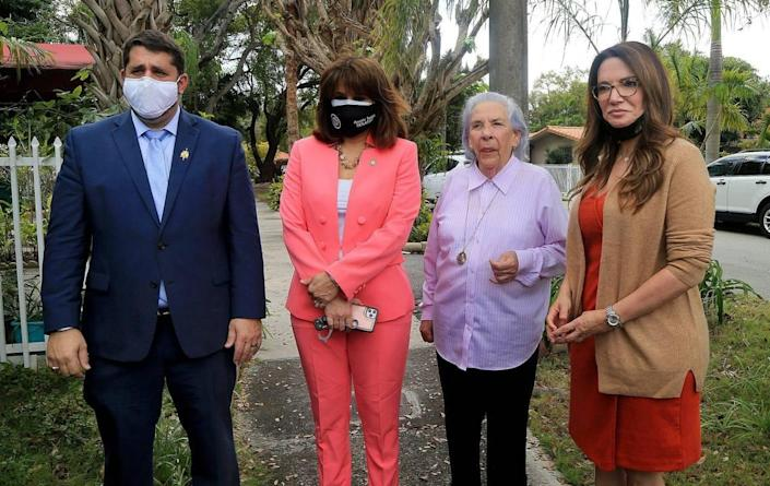 Attorney Bruce Jacobs, state Sens. Annette Taddeo (second from left) and Ileana Garcia (far right) joined together in support of Ana Lazara Rodriguez (second from right), who is an 82-year-old survivor of a Castro prison and lives in a home in Miami that the bank has foreclosed on.