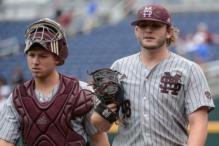 Jun 19, 2018; Omaha, NE, USA; Mississippi State Bulldogs starting pitcher Konnor Pilkington (48) and catcher Dustin Skelton (8) walk to the dugout after warming up before the game against the North Carolina Tar Heels in the College World Series at TD Ameritrade Park. Mandatory Credit: Steven Branscombe-USA TODAY Sports