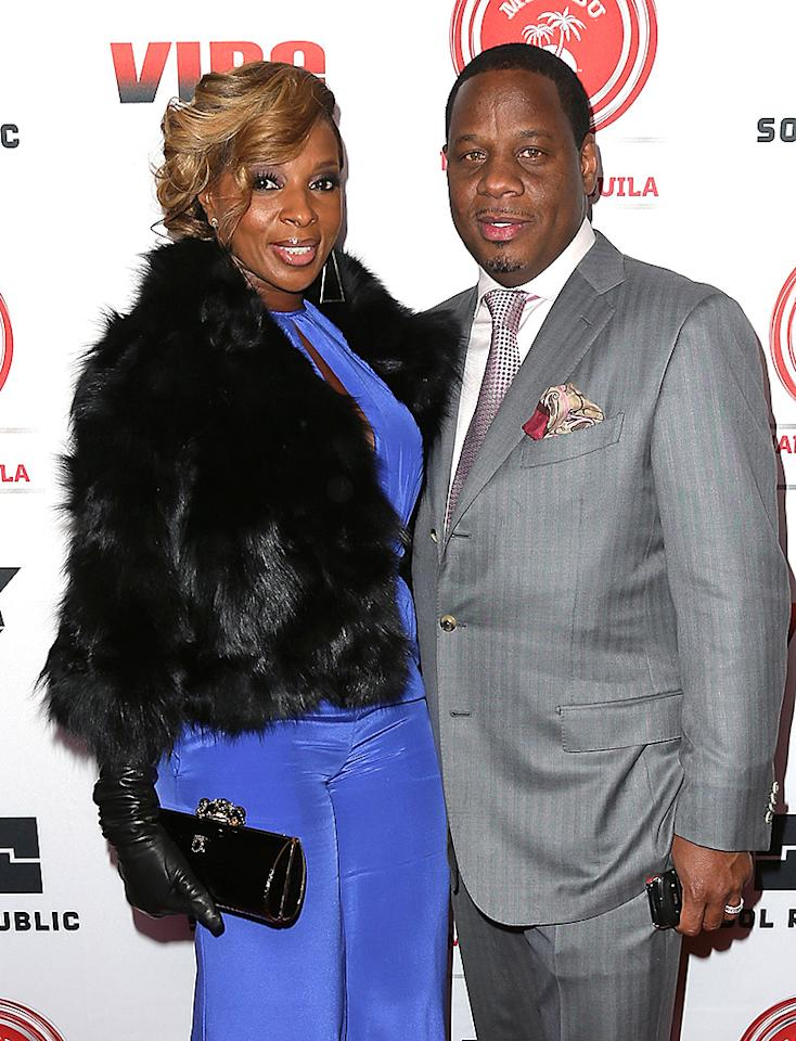 WEST HOLLYWOOD, CA - FEBRUARY 08: Recording artist and evening honoree Mary J. Blige (L) and husband Kendu Isaacs attend VIBE's 20th Anniversary Celebration and Inaugural Impact Awards at the Sunset Tower Hotel on February 8, 2013 in West Hollywood, California. (Photo by David Livingston/Getty Images)