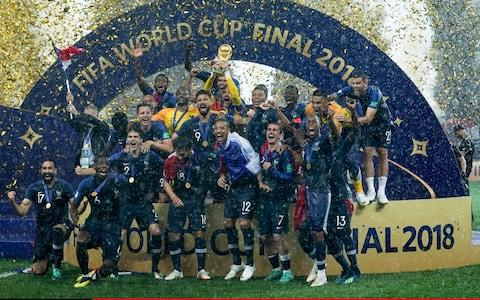 France versus Croatia; French team celebrate after receiving the trophy - Credit: ACTION PLUS