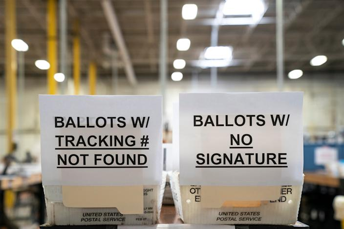 Signage for ballots with errors is seen in a warehouse at the Anne Arundel County Board of Elections headquarters on October 7, 2020 in Glen Burnie, Maryland. The ballot canvas for mail-in and absentee ballots began on October 1st in Maryland, the earliest in the country. Every ballot goes through a five step process before being sliced open and tabulated.