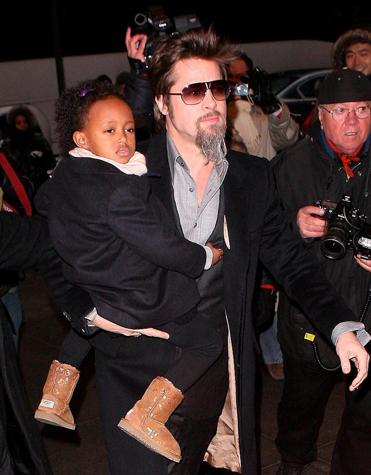 """Oscar nominee Brad Pitt's life is a whirlwind of red carpet movie premieres, black-tie charity galas, and endless travel with Angelina Jolie, daughter Zahara, and the couple's five other little ones. T-N/<a href=""""http://www.x17online.com"""" target=""""new"""">X17 Online</a> - January 3, 2010"""