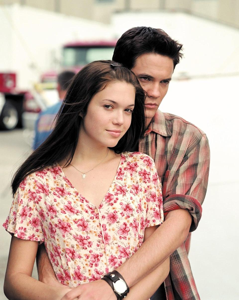"""<p><strong>A Walk To Remember</strong>, which came out in 2002, is a classic, and playing Jamie Sullivan had a long-lasting effect on Moore: it's responsible for her signature brown hair color. """"I went brunette for that movie, so that was a huge change for me,"""" she said. """"And I loved it so much that I kept it for a long time and never really went back. I dabbled a little bit going blond, but really, for the last 20 years, I've embraced the darker side.""""</p>"""
