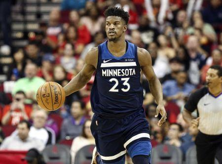 Feb 23, 2018; Houston, TX, USA; Minnesota Timberwolves guard Jimmy Butler (23) dribbles the ball during the third quarter against the Houston Rockets at Toyota Center. Mandatory Credit: Troy Taormina-USA TODAY Sports