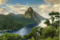 """<p>This glorious island in the Eastern Caribbean might surprise first-time visitors by how much it resembles a Hawaiian island. This charming destination features an abundance of terrain, from the aptly named, iconic Sugar Beach to the stunning Piton volcanic mountains. Visitors can always expect thoughtful hospitality, a taste of the French-inspired Caribbean culture, and mystical views.</p><p><a href=""""https://www.marigotbayresort.com/"""" rel=""""nofollow noopener"""" target=""""_blank"""" data-ylk=""""slk:Marigot Bay Resort"""" class=""""link rapid-noclick-resp"""">Marigot Bay Resort</a> offers Caribbean luxury at its finest with its penthouse and residential accommodations, fabulous spa, and glamorous marina for sailing and shopping.</p>"""
