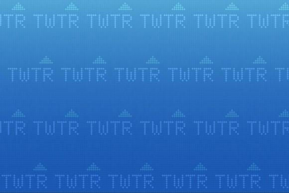 Screen of TWTR stock tickers with up arrows on a blue background.