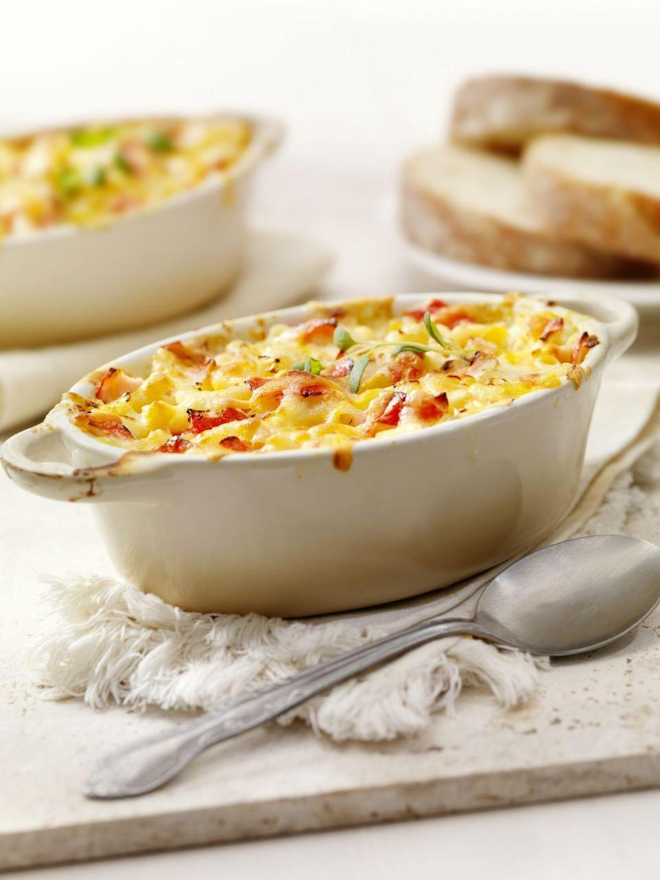 """<p>This elegant casserole was inspired by the tuna-noodle childhood favorite. It can be baked in individual casseroles or in one large dish and served buffet style.</p><p><strong><a href=""""https://www.countryliving.com/food-drinks/recipes/a1704/lobster-noodle-casserole-3829/"""" rel=""""nofollow noopener"""" target=""""_blank"""" data-ylk=""""slk:Get the recipe."""" class=""""link rapid-noclick-resp"""">Get the recipe.</a></strong></p>"""