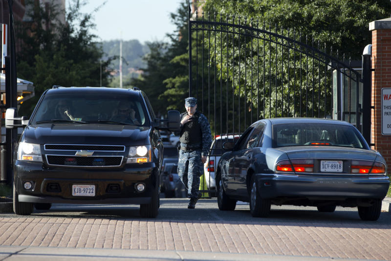 "A member of the Navy checks vehicles at a gate to the Washington Navy Yard, as some employees return, many to retrieve their vehicles, two days after a gunman killed twelve people and was killed himself inside the Navy Yard in Washington, on Wednesday, Sept. 18, 2013. The rampage Monday, Sept. 16, 2013, at the Washington Naval Yard shocked the military, just as the attack at Fort Hood did. Defense Secretary Chuck Hagel ordered a review of base security worldwide, and the issuing of security clearances that allow access to them, vowing: ""Where there are gaps, we will close them."" (AP Photo/Jacquelyn Martin)"