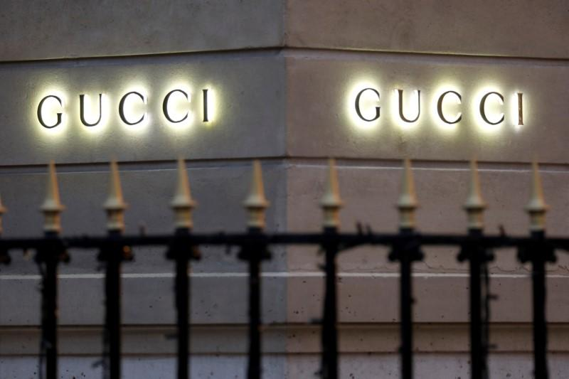 FILE PHOTO: Gucci signs are seen outside a shop in Paris