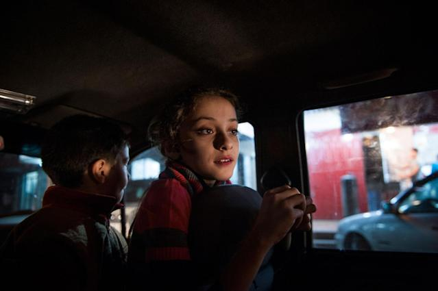 <p>Yara and her brother wait for their father to return with schwarma as an evening treat after a recent conflict ended. (Photograph by Monique Jaques) </p>