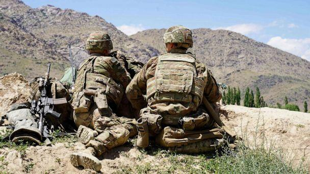 PHOTO: In this file photo taken on June 6, 2019, U.S. soldiers look out over hillsides during a visit of the commander of US and NATO forces in Afghanistan General at the Afghan National Army (ANA) checkpoint in Nerkh district of Wardak province. (Thomas Watkins/AFP via Getty Images, File)
