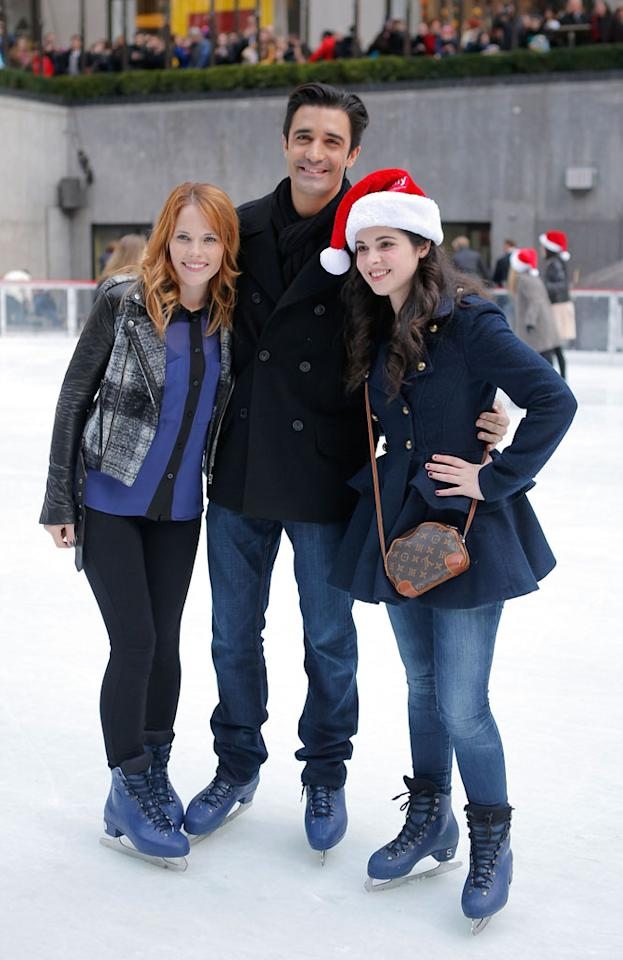 """Katie Leclerc, Gilles Marini and Vanessa Marano skate at Rockefeller Center Ice Rink during ABC Family's """"25 Days Of Christmas"""" Winter Wonderland Event at Rockefeller Center on December 2, 2012 in New York City."""