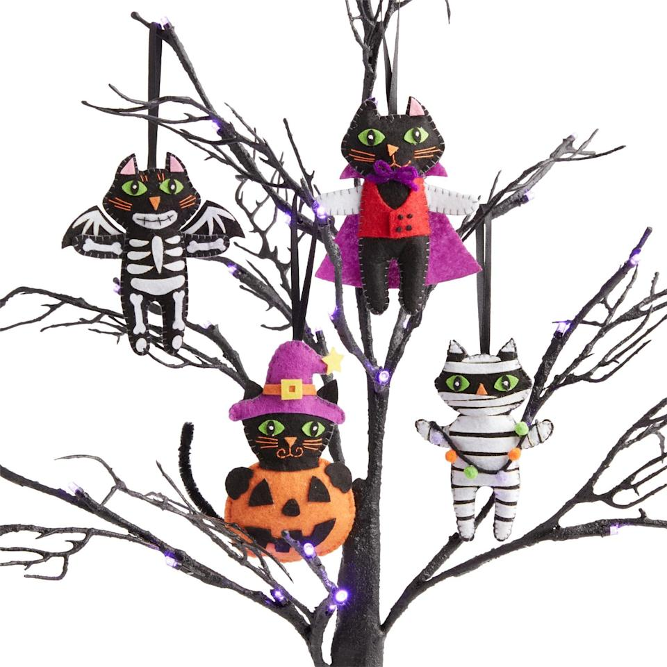 """<p>Revel in the <a href=""""http://www.popsugar.com/home/halloween-tree-ornaments-48494527"""" class=""""link rapid-noclick-resp"""" rel=""""nofollow noopener"""" target=""""_blank"""" data-ylk=""""slk:holiday spirit"""">holiday spirit</a> with this set of cute skeleton, vampire, pumpkin, and mummy <span>Felt-Costumed Cat Cloth Halloween Ornaments</span> ($13) with blanket-stitched edges.</p>"""