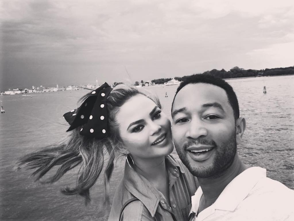 "<p>Leave it to the model to look Minnie Mouse-chic in Italy. Clad in a Disney-esque bow, Chrissy posed with John for a romantic photo by the water. (Photo: <a rel=""nofollow"" href=""https://www.instagram.com/p/BXfxAixAPH6/?taken-by=johnlegend"">John legend via Instagram</a>) </p>"