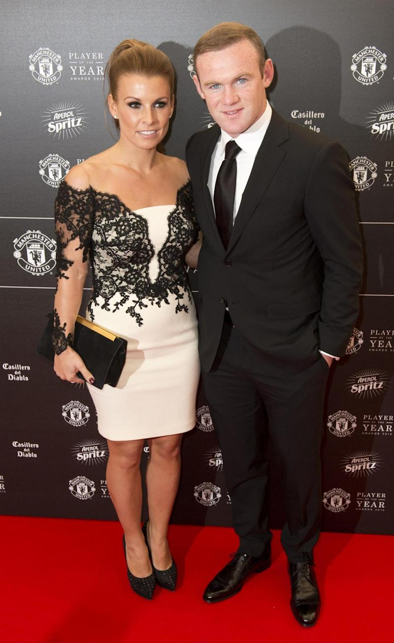 Rooney: With his wife, Coleen (AFP/Getty Images)