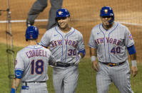 New York Mets Michael Conforto (30) is congratulated by his teammates Ryan Cordell (18) and Wilson Ramos (40) after hitting a home run during the fourth inning of a baseball game against the Washington Nationals in Washington, Tuesday, Aug. 4, 2020. Ramos also scored. (AP Photo/Manuel Balce Ceneta)