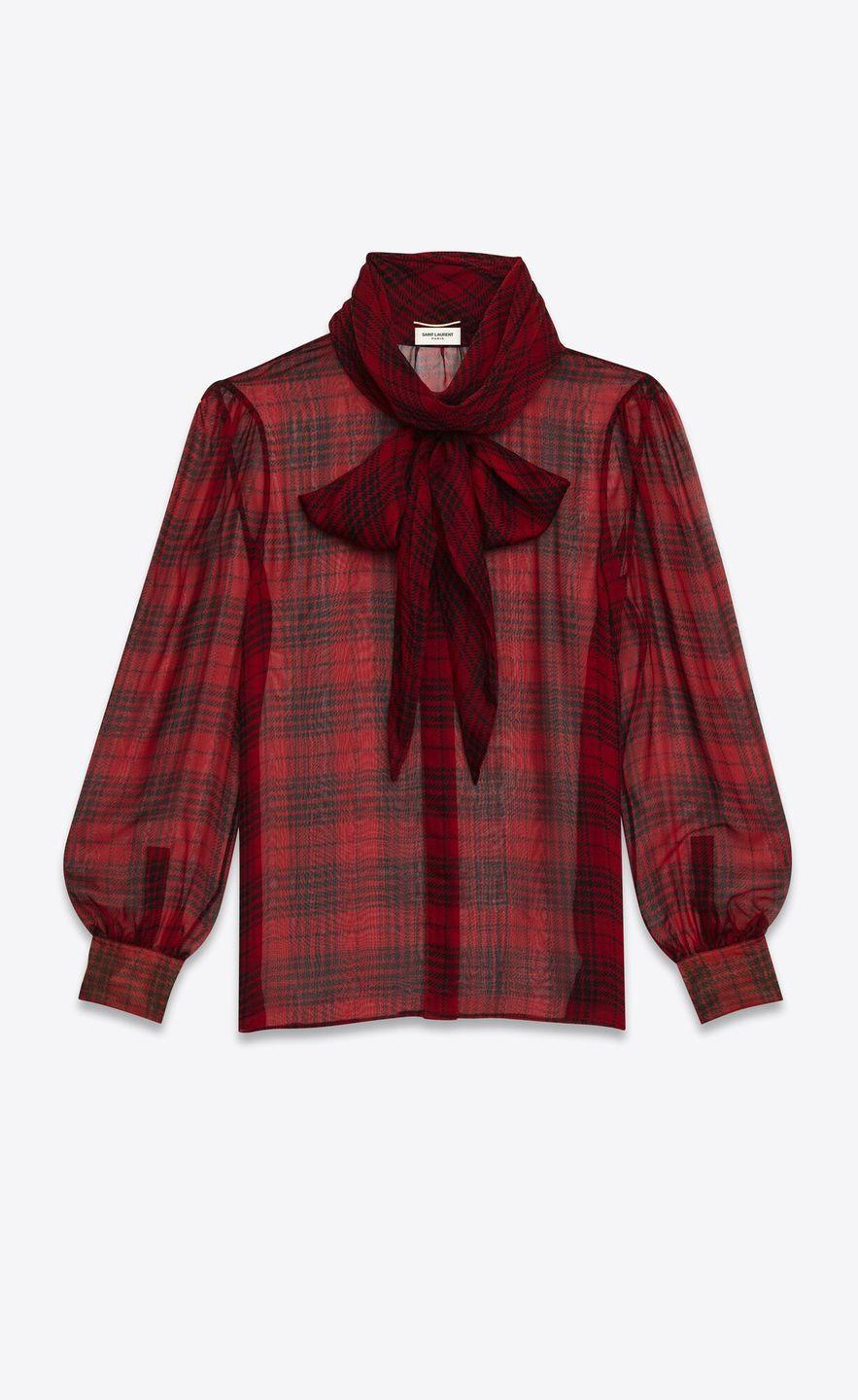 """<p>Silk muslin blouse, price on request, Saint Laurent by Anthony Vaccarello.</p><p><a class=""""link rapid-noclick-resp"""" href=""""https://www.ysl.com/en-en/shirts-and-blouses/lavalliere-neck-blouse-in-prince-of-wales-check-silk-muslin-641585Y8B866041.html"""" rel=""""nofollow noopener"""" target=""""_blank"""" data-ylk=""""slk:SHOP NOW"""">SHOP NOW</a></p>"""