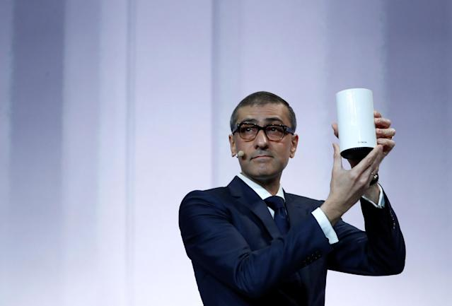 Rajeev Suri, Nokia's President and Chief Executive Officer, shows a Wi-Fi device during the Mobile World Congress in Barcelona, Spain February 25, 2018. REUTERS/Yves Herman