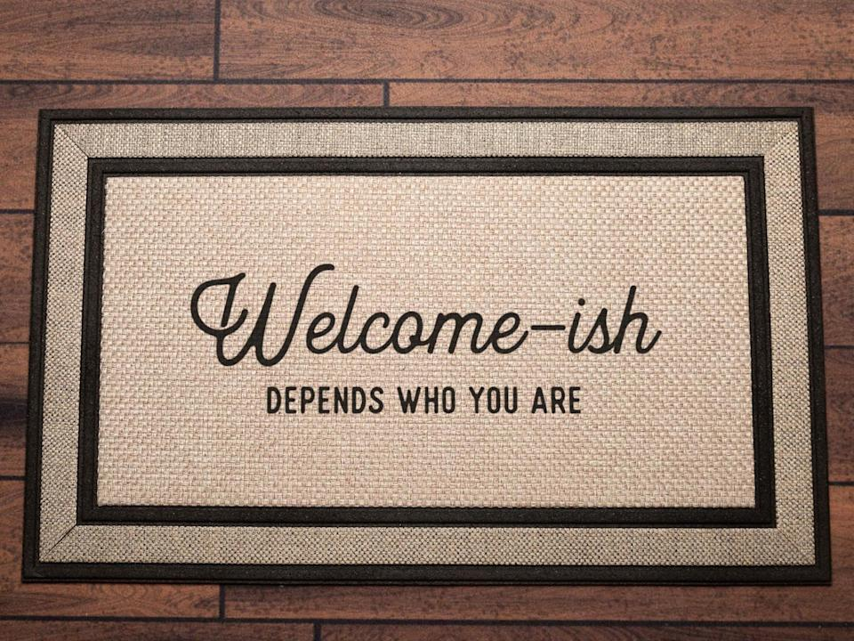 <p>Who wouldn't want to make a humorous first impression with this <span>ACustomShop Welcome-ish Doormat</span> ($60)?</p>