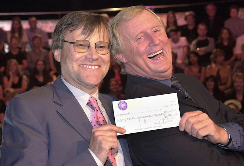 Coronation Street actor David Nielson (Roy Cropper) with his cheque for 64,000 presented by Chris Tarrant whilst playing the hit television quiz show, Who Wants to be a Millionaire?at Elstree Studios. The soap stars were hoping to win a fortune for charity. * in the special edition of the show hosted by Chris Tarrant. (Photo by Tim Ockenden - PA Images/PA Images via Getty Images)