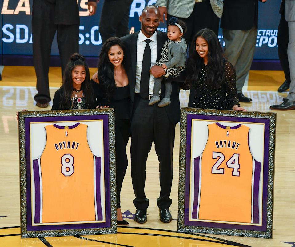 Kobe Bryant is joined by his family, Gianna, Vanessa, Bianka and Natalia, during a ceremony retiring his two uniform numbers at Staples Center in Los Angeles on Dec 18, 2017.