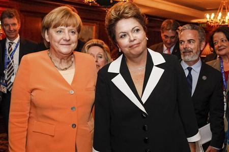 Brazil's President Rousseff and German Chancellor Merkel pose during a meeting at Santiago