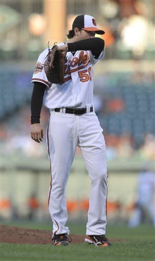 Baltimore Orioles pitcher Miguel Gonzalez reacts after hitting a second Tampa Bay Rays batter in the first inning of a baseball game Wednesday, July 25, 2012, in Baltimore. (AP Photo/Gail Burton)