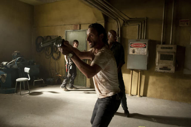 "Rick Grimes (Andrew Lincoln), Daryl Dixon (Norman Reedus) and Oscar (Vincent Ward) in ""The Walking Dead"" episode, ""Killer Within."""