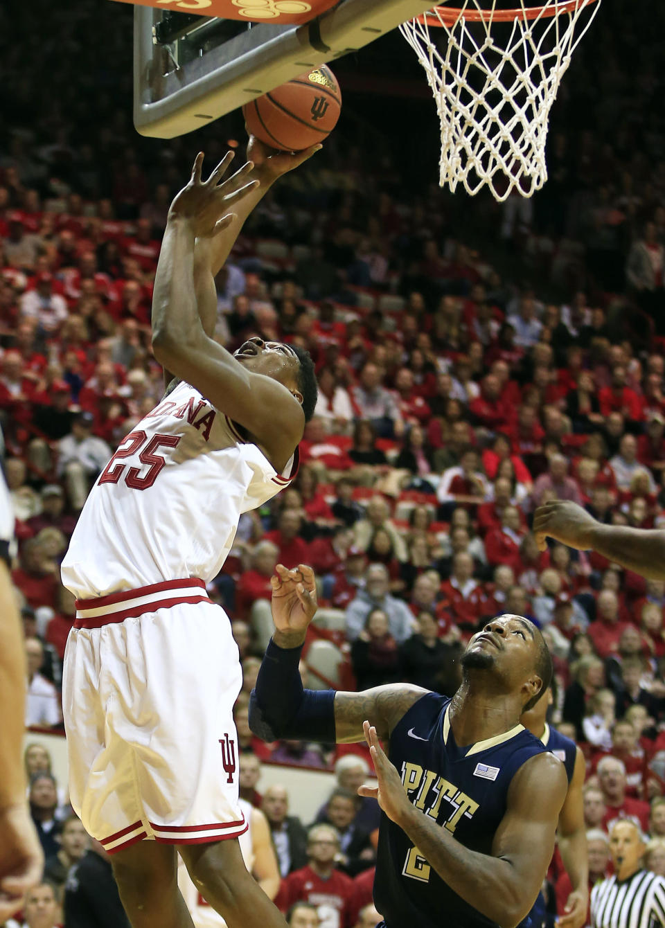 Indiana's Emmitt Holt (25) puts up a shot against Pittsburgh's Michael Young (2) during the second half of an NCAA college basketball game Tuesday, Dec. 2, 2014, in Bloomington, Ind. Indiana won 81-69. (AP Photo/Darron Cummings)