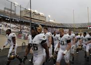 Army 's Larry Dixon (26) and Ryan Alexander (50) lead the rest of the team back into the locker room after their game against Louisiana Tech was stopped due to weather in the first half of a NCAA college football game, Saturday, Sept. 28, 2013, in Dallas. (AP Photo/Tony Gutierrez)