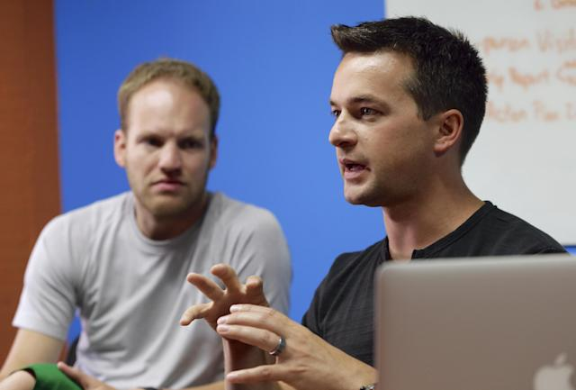In this photo from Aug. 14, 2014, David Graff, CEO, left, and John Wirtz, Chief Product Officer of Hudl speak in Lincoln, Neb. Hudl is a software company that has developed a way to immediately get game film to coaches after games and break down and separate different plays by type. (AP Photo/Nati Harnik)